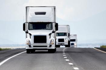 picture of a fleet of trucks driving along the highway