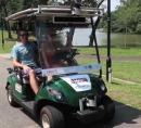 Photo of autonomous golf cart.